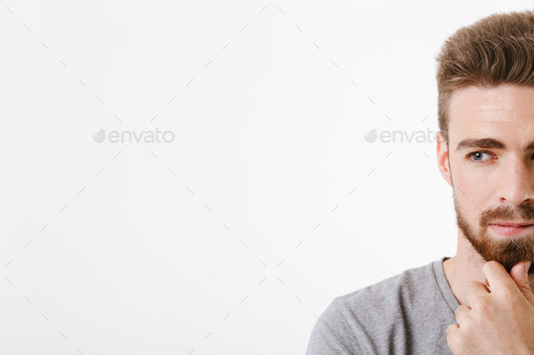 Thoughtful concentrated young man - Stock Photo - Images