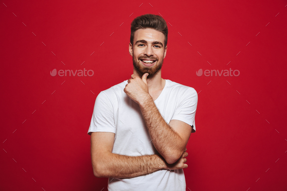 Handsome cheerful young man in white t-shirt - Stock Photo - Images