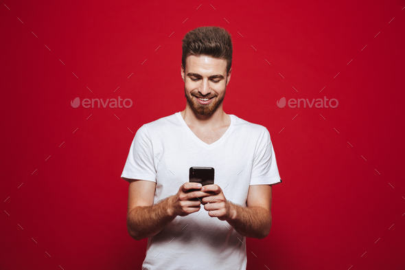 Portrait of a happy young bearded man - Stock Photo - Images