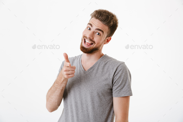 Handsome cheerful young man pointing to you. - Stock Photo - Images