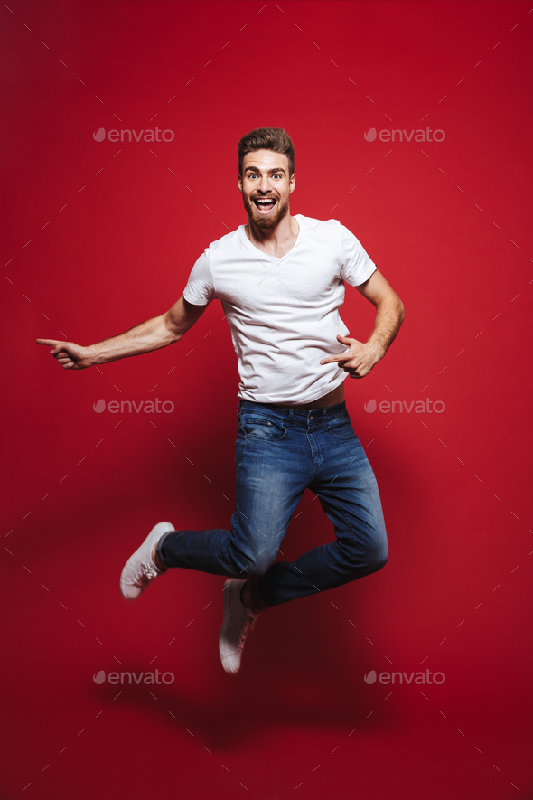 Full length portrait of a happy young bearded man - Stock Photo - Images