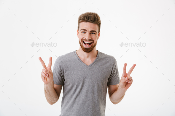 Portrait of a cheerful young bearded man - Stock Photo - Images