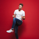 Full length portrait of a cheerful young bearded man - PhotoDune Item for Sale