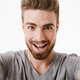 Portrait of an excited young bearded man - PhotoDune Item for Sale