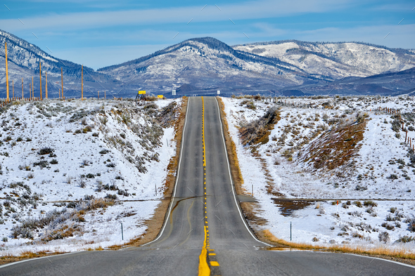 Season changing, first snow along highway - Stock Photo - Images