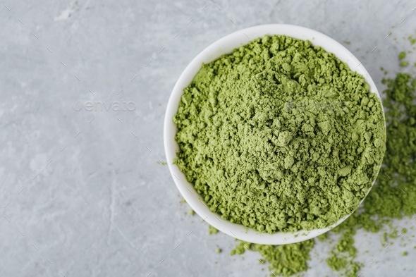 Green matcha tea powder in white bowl - Stock Photo - Images