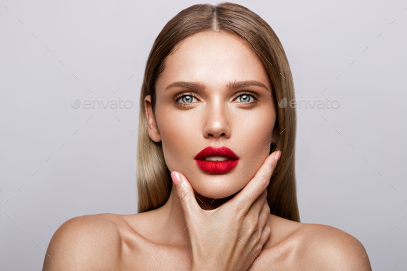 Beautiful young model with red lips - Stock Photo - Images