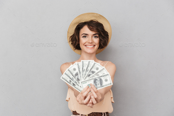 Portrait of a happy young woman in summer hat - Stock Photo - Images