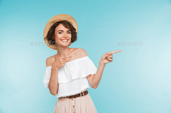 Portrait of a smiling young woman in summer hat - Stock Photo - Images