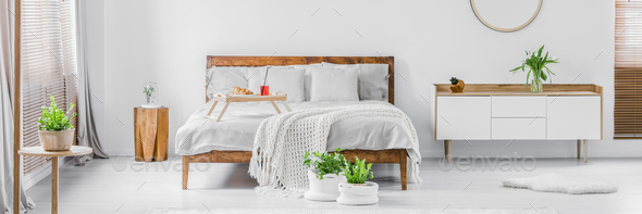 Panorama of a bright white and wooden bedroom interior with doub - Stock Photo - Images