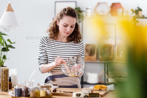 Vegan woman mixing natural ingredients - Stock Photo - Images