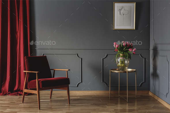 Simple waiting room interior with a single red armchair standing - Stock Photo - Images