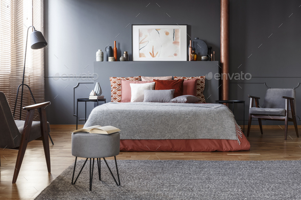 Real photo of cozy, dark bedroom interior with many decorative c - Stock Photo - Images