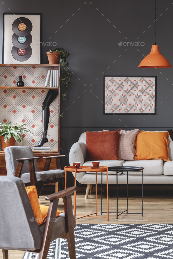 Retro living room interior with armchairs, sofa decorated with o - Stock Photo - Images