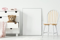 Poster with mockup between chair and cabinet with teddy bear in - PhotoDune Item for Sale