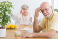 Tired elderly man arguing with his wife in the morning - PhotoDune Item for Sale