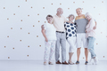 Group of elderly friends hugging each other in white studio with - PhotoDune Item for Sale