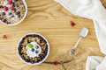 Top view of a wooden breakfast table with two bowls of oatmeal w - PhotoDune Item for Sale