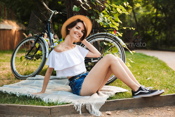 Smiling young girl resting on a blanket - Stock Photo - Images