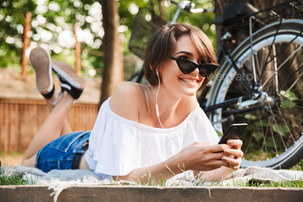 Happy young girl listening to music with mobile phone - Stock Photo - Images