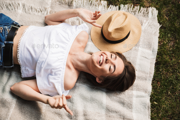 Top view of a happy young girl laying on a blanket - Stock Photo - Images