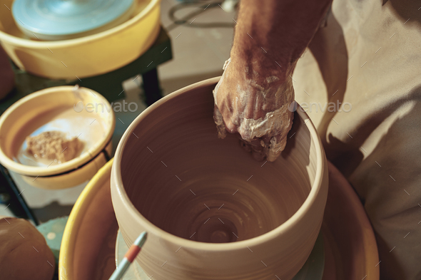 Creating a jar or vase of white clay close-up. Master crock. - Stock Photo - Images