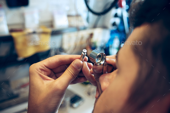 Different goldsmiths tools on the jewelry workplace. Jeweler at work in jewelry. - Stock Photo - Images