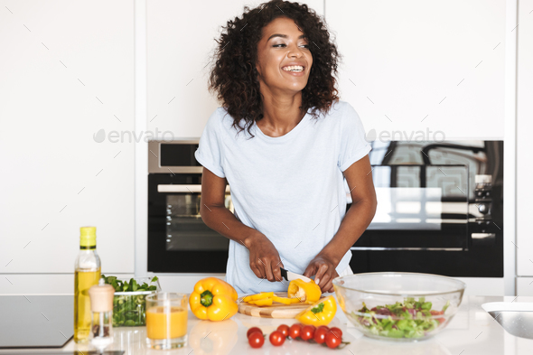 Portrait of a laughing afro american woman - Stock Photo - Images