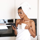 Smiling african woman wrapped in a towel - PhotoDune Item for Sale
