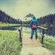 Active man standing at Atorno Lake at Tre Cime di Lavaredo, Ital - PhotoDune Item for Sale