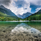 Clear water and Julian Alps reflection in Lake Jasna, Slovenia - PhotoDune Item for Sale