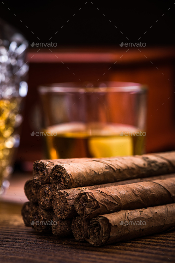 Cuban cigars on wooden table with humidor and cognac - Stock Photo - Images