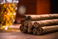 Cuban cigars on wooden table, close up detail