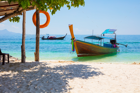 Longtail Boat Moored At Beach On Sunny Day - Stock Photo - Images