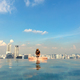 Female Tourist In Infinity Pool Of Marina Bay Singapore - PhotoDune Item for Sale