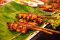 Chicken Satay Served On Banana Leaves At Street Market - PhotoDune Item for Sale