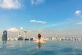 Female Tourist In Infinity Pool Of Marina Bay Singapore - PhotoDune Item for Sale