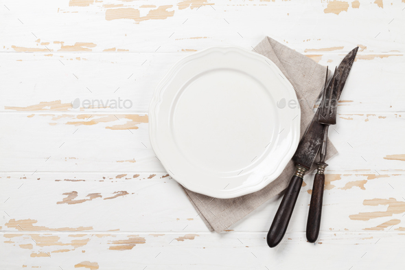 Empty plate with utensils - Stock Photo - Images