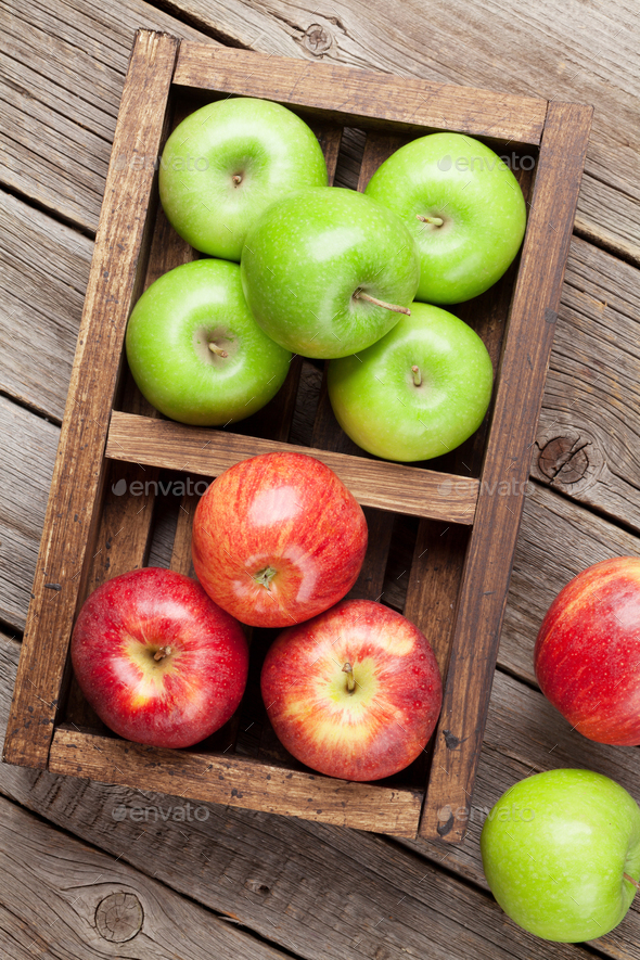 Green and red apples in wooden box - Stock Photo - Images