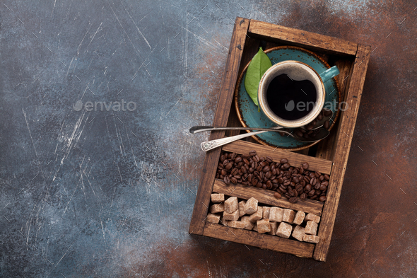 Coffee cup, roasted beans and brown sugar - Stock Photo - Images