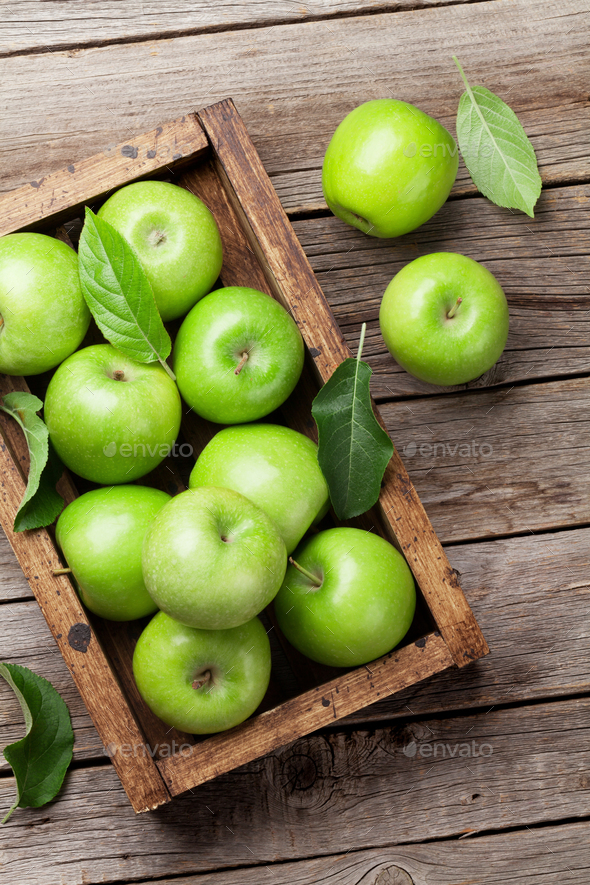 Green apples in wooden box - Stock Photo - Images