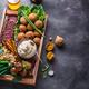 Assorted meze on a dark background. Meat, falafel, baba ghanoush, vegetables. Copyspace - PhotoDune Item for Sale