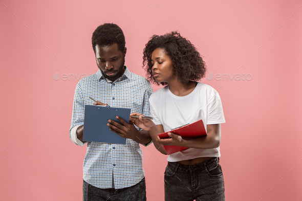 Two african students with folders  - Stock Photo - Images