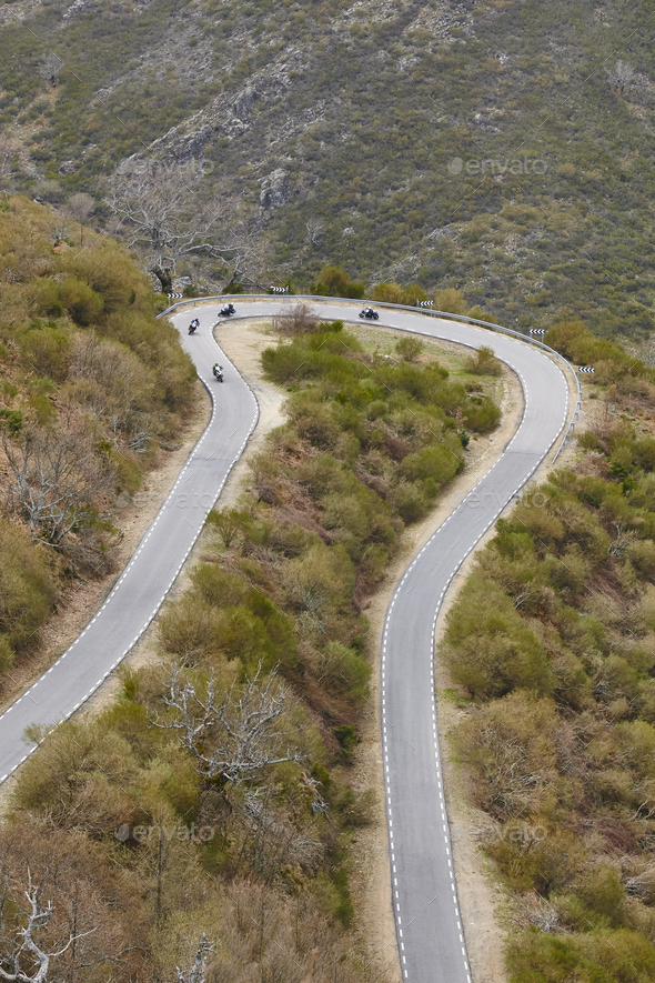 Curved asphalt mountain road with motorcycles. Rural scenic travel. Vertical - Stock Photo - Images