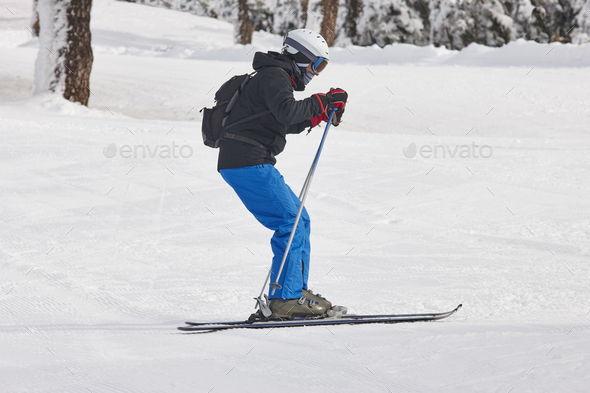 Adult skiing on a snowy hill landscape. Winter sport. Horizontal - Stock Photo - Images