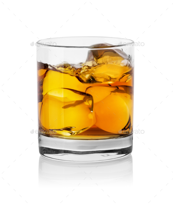 Glass with whiskey and ice cubes - Stock Photo - Images