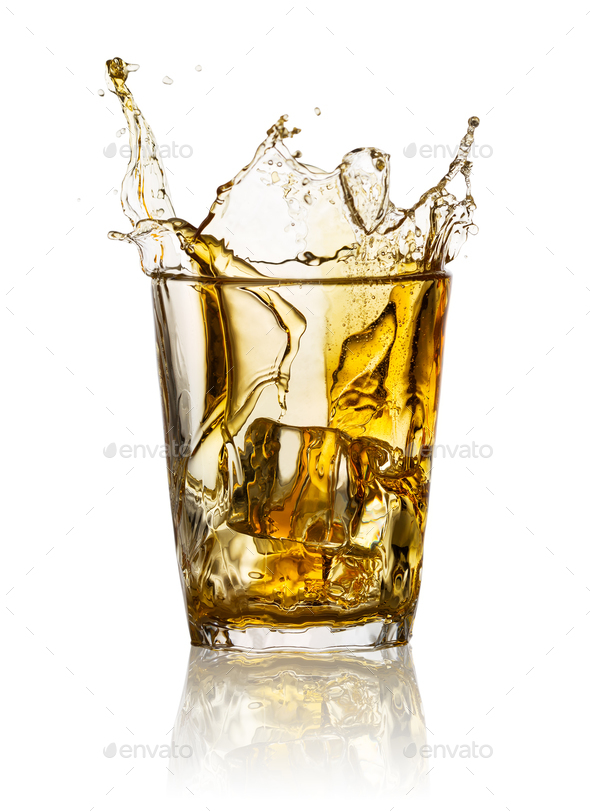 Splash in glass of whiskey - Stock Photo - Images