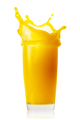 Splash in transparent glass of orange juice - PhotoDune Item for Sale
