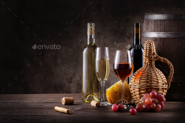 Wine still life on a wooden table - Stock Photo - Images