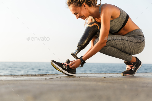 Smiling disabled athlete woman - Stock Photo - Images